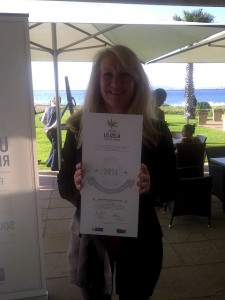 Leigh Longden with the Lilizela Tourism Awards certificate.